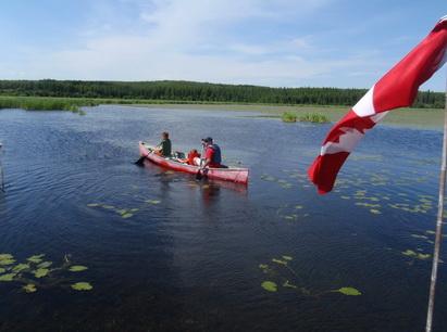 kelly w boys and flag canoeing_resize